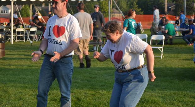 Sean Breen (left), of Glenview, and Karen Roscher, of Highwood, show off their dance moves at the fifth annual NSSRA Summer Bash on Aug. 13 in Northbrook.